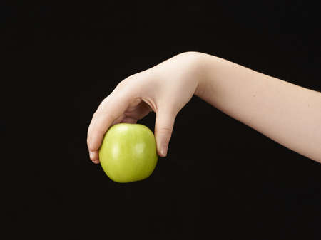Childs hand with apple photo