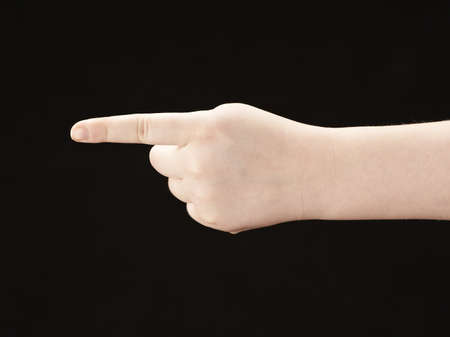 Childs hand with index finger pointing photo