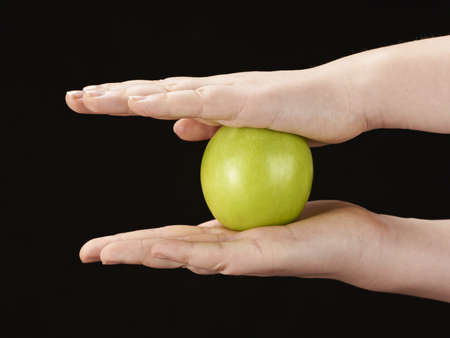Childs hands with apple photo