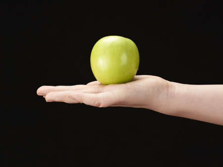 Childs hand with apple in palm