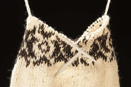 Knitted sweater - on black background