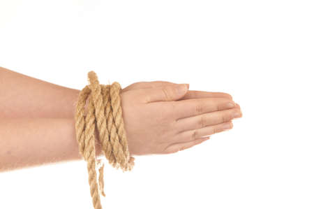Hands tied with natural hemp isolated on white background Stock Photo