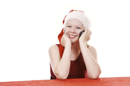 Beautiful young girl in christmas outfit talking in cell phone - isolated on white background Stock Photo - 16336013