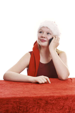 Beautiful young girl in christmas outfit talking in cell phone - isolated on white background Stock Photo