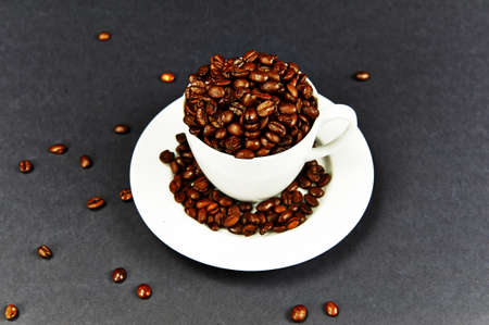 Coffee cup on a dish and coffee beans photo