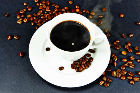Steaming hot cup of black coffee Stock Photo