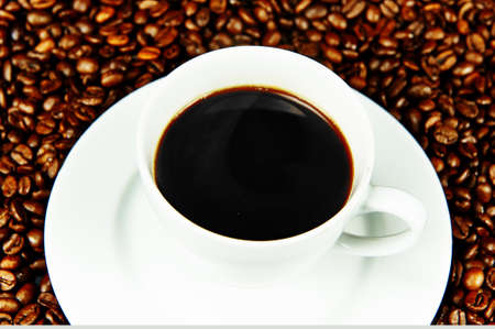 Steaming hot cup of black coffee photo