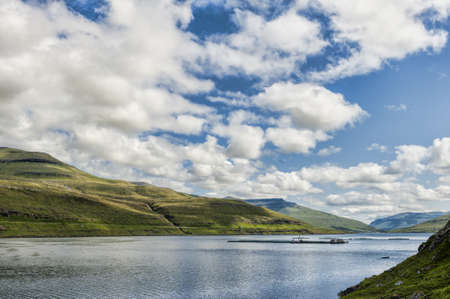 Lachszucht auf den Färöer-Inseln Standard-Bild - 21612606