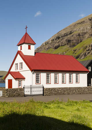 Small village church in Tjornuvik in the Faroe Islands Stock Photo