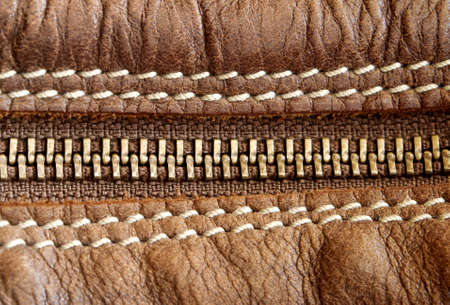 Close up of zipper and leather stitch detail