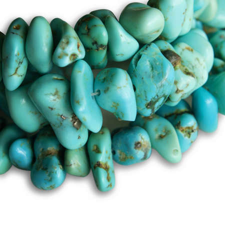 Close up of turquoise stone necklace isolated on white background  Stock Photo