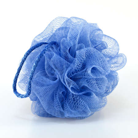 Soft blue bath puff or sponge with rode handle isolated on white background