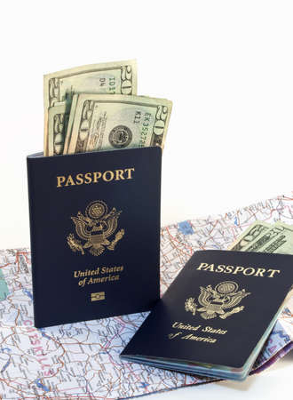 overseas visa: Two American passports with paper money and open map isolated on white background. Stock Photo