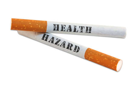 Two cigarettes with health hazard written warning isolated on white background with plenty of copy space. Stockfoto