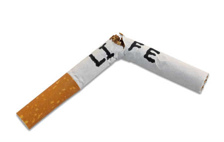 Cigarette broken in half with life written across it indicating concept that smoking cuts a human life short isolated on white background.