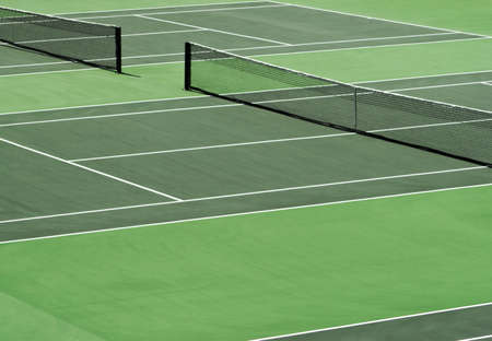 tennis stadium: Aerial image of empty outdoor green hard tennis court with nets. Stock Photo