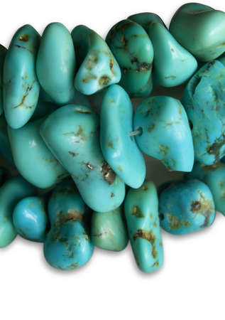 Close up of beautiful turquoise stones isolated on white background.