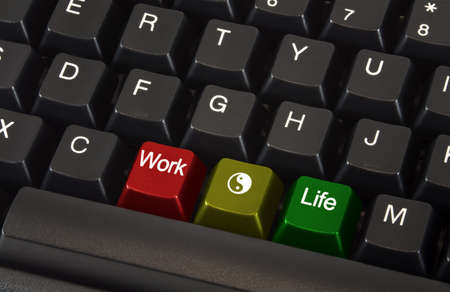 Close up of black keyboard with work life balance concept on different colored keys. photo