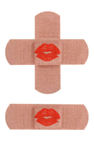 Set of adhesive medical bandages or bandaids with red kisses isolated on white background  photo