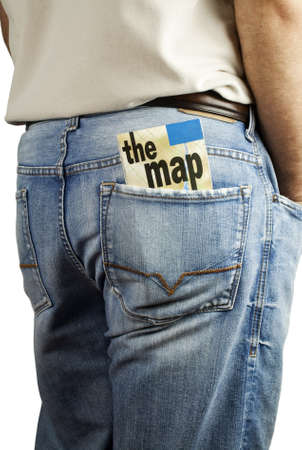 Man standing with travel map in back pocket of denim blue jeans with copy space   photo