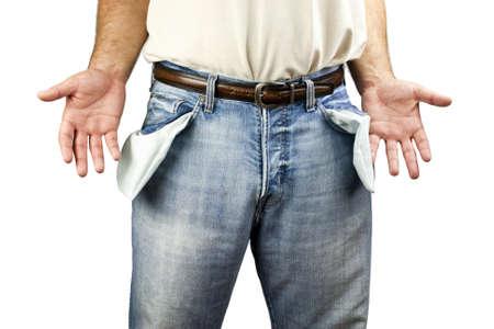 bolsillos vacios: Hombre desempleado joven vestido con pantalones de mezclilla azul que muestran los bolsillos vac�os aislados en fondo blanco con copia espacio