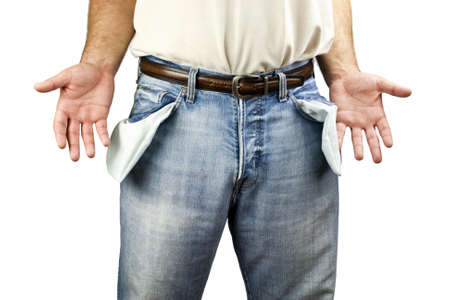 hands on pockets: Young unemployed man dressed in blue denim jeans showing empty pockets isolated on white background with copy space
