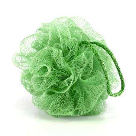 Soft green bath puff or sponge with rope handle isolated on white background