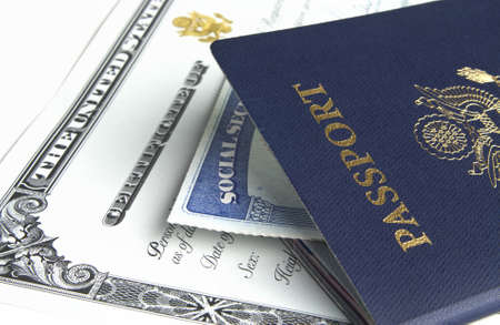 residents: Blue American passport with citizenship documents on white background