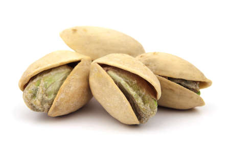 Delicious cracked pistachio nuts isolated on white background.