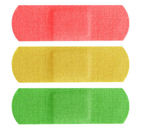 Red, yellow and green color plaster or bandages isolated on white background. Stock Photo - 15096994