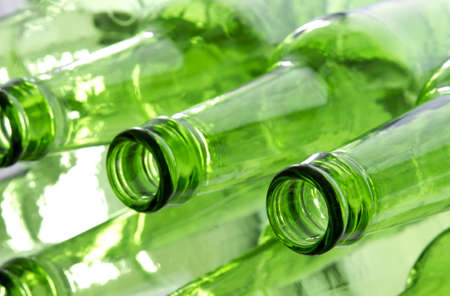 green glass bottle: Bunch of empty glass beer bottles with back lighting. Stock Photo