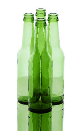 Bunch of empty glass beer bottles with back lighting. photo