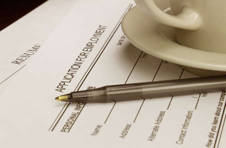 Blank employment application with resume, pen and coffee on desk. Stock Photo - 15545373