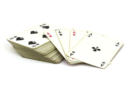 card game: Deck of old playing cards with ace cards on top isolated on white background. Stock Photo
