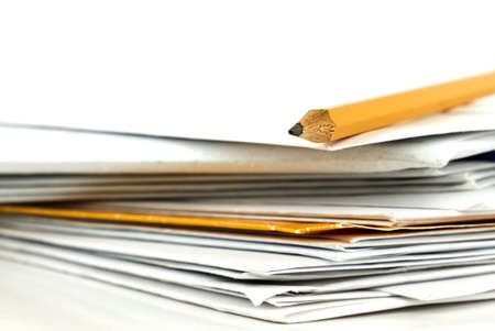 Stack of postal mail with yellow writing pencil on white background. photo