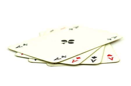 Old playing cards with four ace cards isolated on white background