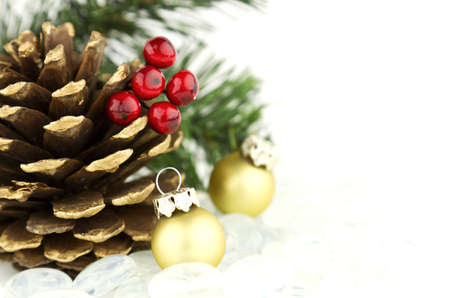 Beautiful seasonal Christmas holiday theme with pine cones and colorful ornaments  photo