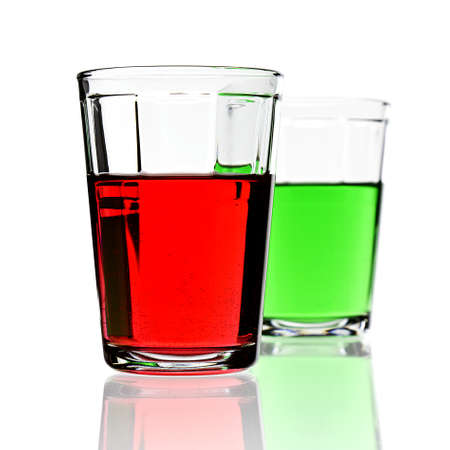Red and green drinks in glasses isolated on white with copy space. photo