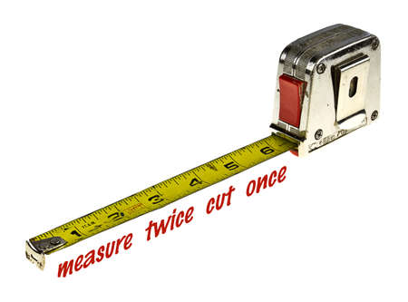 Tape measure with measure twice cut once text isolated on white with copy space.