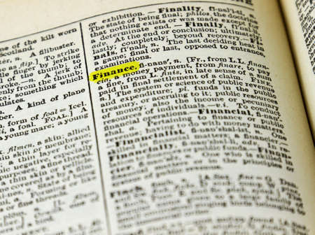 english dictionary: Word FINANCE highlighted on a dictionary page.