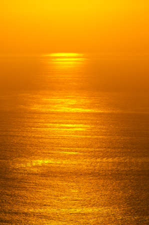 Sunrise glow of ocean photo