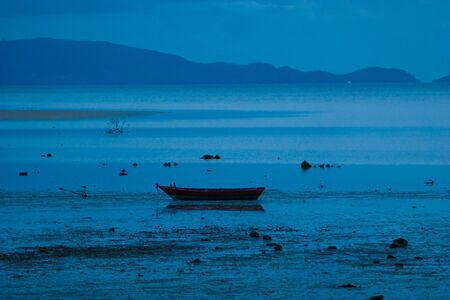 Picture of empty long tail boat on tropical beach at night. Ko li pe island.