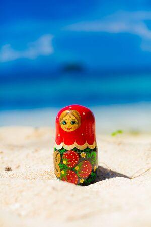 russian dolls: Photo Russian Dolls Matrioshka Souvenir Untouched Sunny Tropical Beach in Bali Island. Vertical Picture. Blurred Background. Closeup
