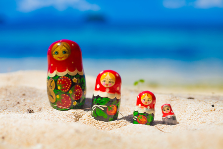 matrioska: Photo Rows Puzzle Russian Dolls Matrioshka Souvenir Untouched Tropical Beach in Bali Island. Horizontal Picture. Blurred Background. Closeup