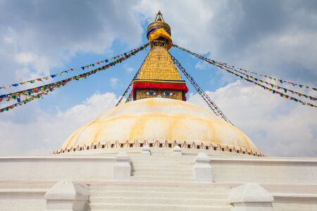 dome of hindu temple: Photo of Boudhanath Stupa in the Kathmandu valley with clouds the sky Nepal. Horizontal