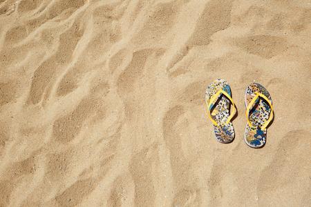 no body: Closeup Beach Sandals Flip Flops or Tongs Sandy Beach Background Copyspace. Summer Concept. Horizontal. No body photo