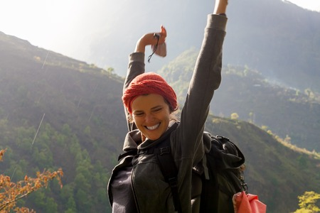 Portrait Young Pretty Girl Sunrise Rain Mountains.Africa Nature Morning Volcano Viewpoint.Mountain Trekking,View Landscape.Woman Happy Smiling.Horizontal picture.First Rays Rising Sun