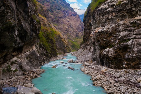 Landscape Fast Mountains River Hiking Himalayas.Beautiful View Waterfalls End Summer Season Background.Green Threes Cloudy Blue Sky Mountainous Rocks Nobody Image.Horizontal Photo