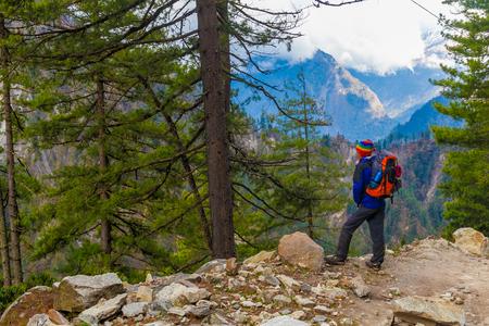 Young Sport Man Wearing Jacket Backpack Trail Mountains.Mountain Trekking Rocks Path Landscape Beautiful View Background.Woman Happy Smiling Close Rock.Horizontal Photo