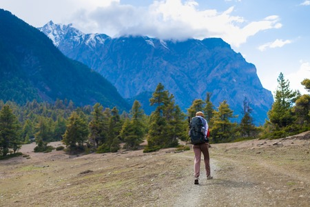 Young Pretty Woman Wearing Red Jacket Backpack Trail Mountains.Asia Mountain Trekking Rocks Path Landscape View Background. Girl Happy Hikking Route.Horizontal Photo Stock Photo